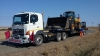 Cartage by low bed trailer